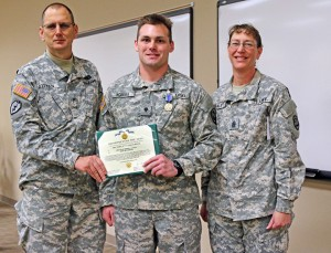 Spc. Derek G. Accola, an Ames resident serving with the Iowa Army National Guard's 186th Military Police Company based in Johnston, took first place in the Iowa National Guard's Best Warrior Soldier of the Year competition. Here, he's presented the Army Achievement Medal by the Iowa Army National Guard's Deputy Commanding General Steve Altman and State Command Sergeant Major Rachel Fails.