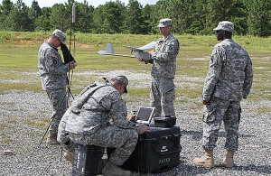Army Staff Sgt. Roderick Thigpen, Operations Group, Joint Readiness Training Center, from St. Louis, Ill., instructs Iowa National Guard soldiers on how to run tests and checks on the Unmanned Aerial Vehicle (UAV) prior to launching, at Fort Polk, La., July 28. Thigpen is a certified operator for the UAV, who trains and validates Soldiers in reconnaissance aircraft operations. (Iowa National Guard Photo by Sgt. Renee Seruntine)