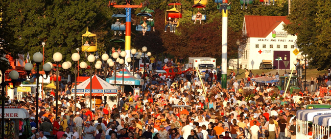 Fairgoers walking along the Grand Concourse at the 2004 Sesquicentennial Iowa State Fair on Saturday August 21, 2004 in Des Moines, IA.  (Iowa State Fair Photo)