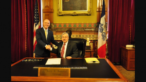 AFP Liaison, Drew Klein, shakes hands with Gov. Branstad